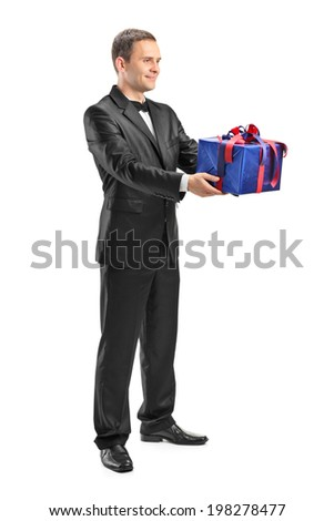 Full length portrait of a guy holding a present isolated on white background - stock photo
