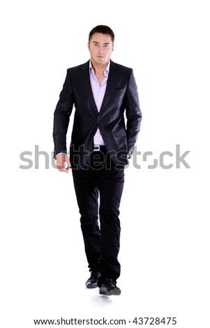 Full length portrait of a handsome man - stock photo