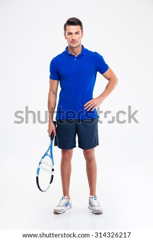 Full length portrait of a handsome sports man standing with tennis racket isolated on a white background - stock photo