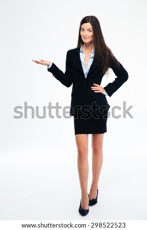 Full length portrait of a happy businesswoman holding copyspace on the palm isolated on a white background - stock photo