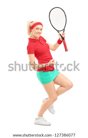 Full length portrait of a happy female tennis player isolated on white background - stock photo