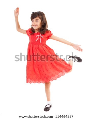 Full length portrait of a happy little girl playing, isolated on white background - stock photo