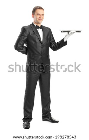 Full length portrait of a happy waiter holding a tray isolated on white background - stock photo