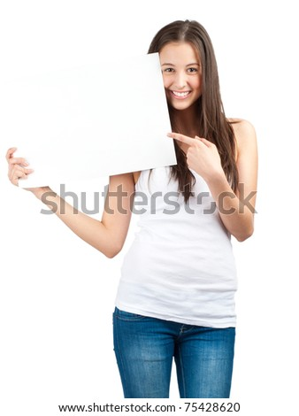 Full length portrait of a happy young casual woman holding a blank signboard and pointing, isolated on white background - stock photo