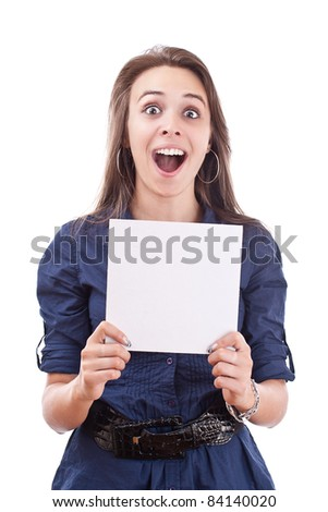 Full length portrait of a happy young woman showing a blank board over white isolated background - stock photo