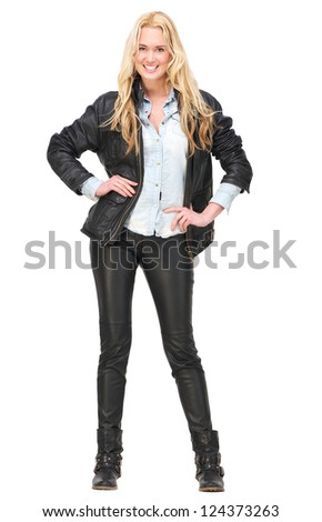 Full length portrait of a happy young woman smiling with hands on hips. Isolated on white background - stock photo