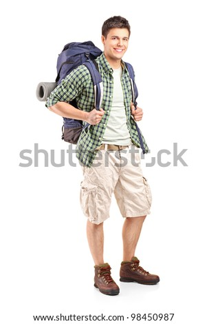 Full length portrait of a hiker with backpack posing isolated on white background - stock photo