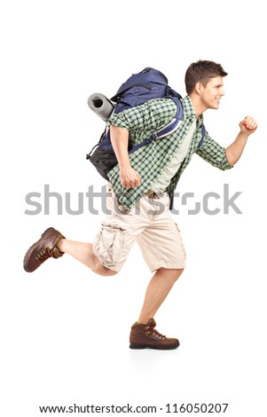 Full length portrait of a hiker with backpack running isolated on white background - stock photo