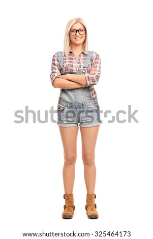 Full length portrait of a hipster girl with large black glasses and a short overalls isolated on white background - stock photo