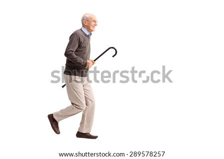 Full length portrait of a joyful senior gentleman carrying a cane in his hand and running isolated on white background - stock photo