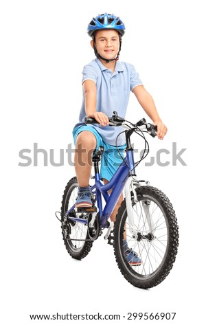 Full length portrait of a little boy with blue helmet sitting on his bicycle and looking at the camera  isolated on white background - stock photo