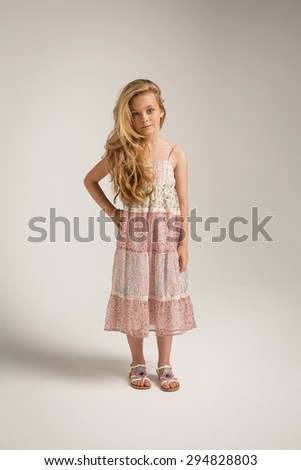 Full length portrait of a little girl in long dress - stock photo