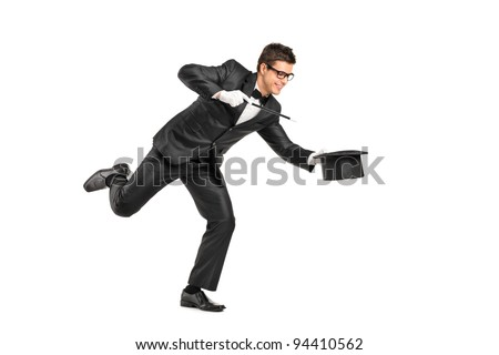 Full length portrait of a magician holding a magic wand and gesturing isolated on white background - stock photo