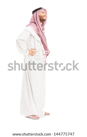 Full length portrait of a male arab person standing isolated on white background - stock photo