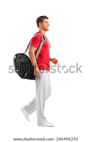 Full length portrait of a male athlete walking with a sports bag isolated on white background - stock photo
