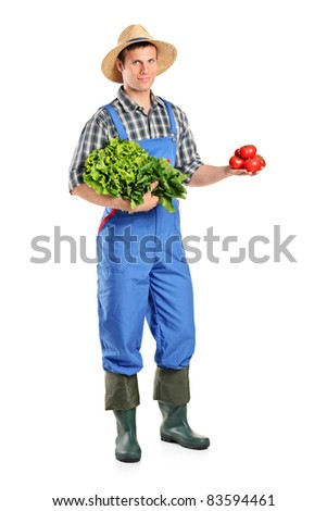 Full length portrait of a male farmer holding vegetables isolated on white background - stock photo