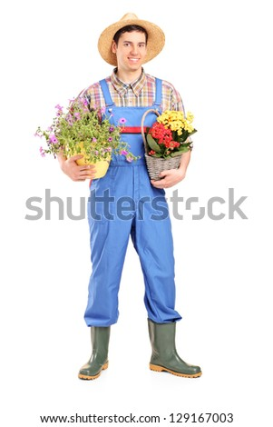 Full length portrait of a male gardener holding plants isolated on white background - stock photo
