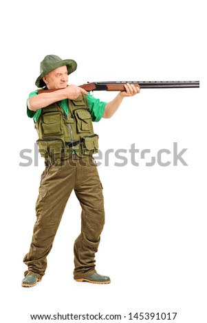 Full length portrait of a male hunter shooting with a rifle, isolated on white background - stock photo