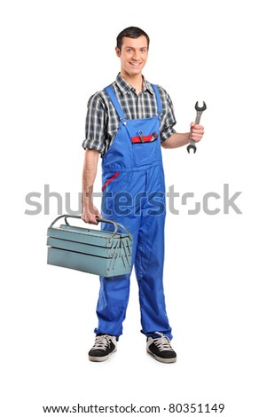 Full length portrait of a male manual worker holding a wrench and tool box isolated on white background - stock photo