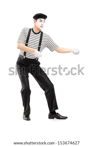 Full length portrait of a male mime artist performing pulling virtual rope isolated on white background - stock photo
