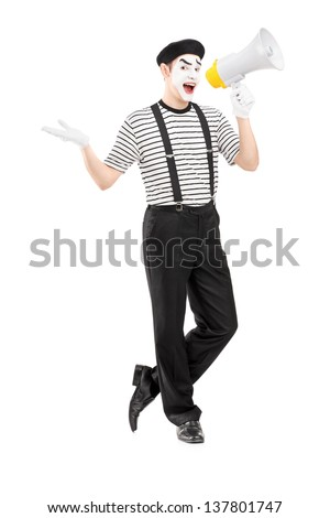Full length portrait of a male mime artist speaking at loudspeaker and looking at camera isolated on white background - stock photo