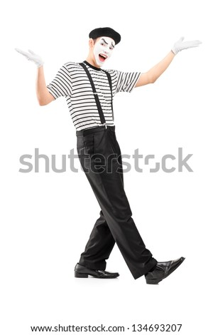 Full length portrait of a male mime dancer gesturing with hands isolated against white background - stock photo