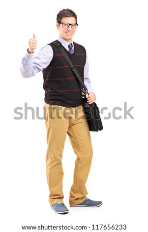 Full length portrait of a male student giving a thumb up isolated on white background - stock photo