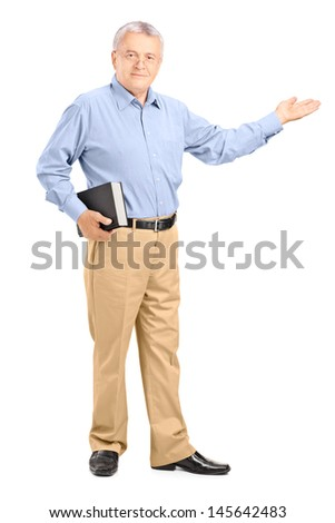 Full length portrait of a male teacher holding a book and gesturing with his hand isolated on white background - stock photo
