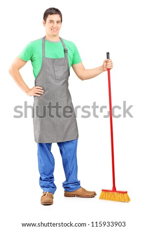 Full length portrait of a man cleaner posing with brush in his hand isolated on white background - stock photo