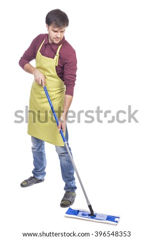 Full length portrait of a man cleaning the floor over white background - stock photo