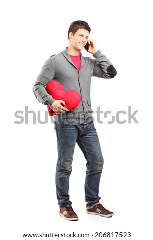 Full length portrait of a man having a romantic conversation on the phone isolated on white background - stock photo