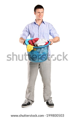 Full length portrait of a man holding a basket full of laundry isolated on white background - stock photo