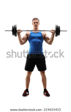 Full length portrait of a man in sportswear exercising with a weight isolated on white background - stock photo