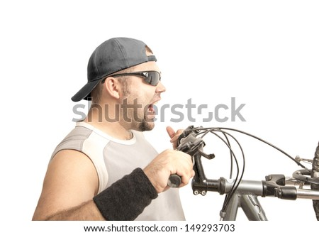Full length portrait of a man riding a bicycle isolated against white background Extremal jump on the bike off the ground the rear wheel - stock photo