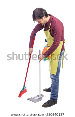 Full length portrait of a man sweeping the floor over white background - stock photo