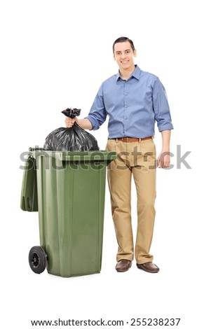 Full length portrait of a man throwing out garbage isolated on white background - stock photo