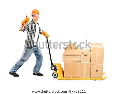 Full length portrait of a manual worker pushing a fork pallet truck stacker isolated on white background - stock photo