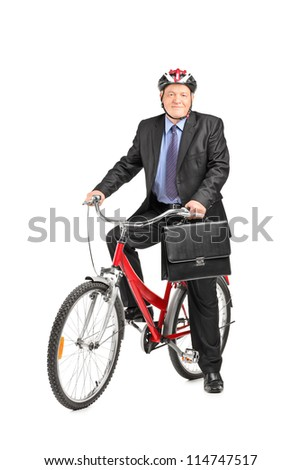 Full length portrait of a mature businessman with briefcase on a bicycle, isolated on white background - stock photo