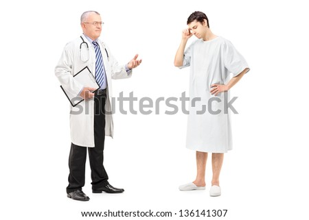 Full length portrait of a mature health specialist talking to a worried patient, isolated on white background - stock photo