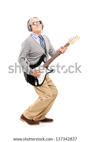 Full length portrait of a mature man playing guitar isolated on white background - stock photo
