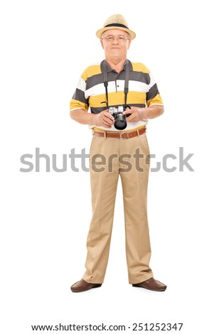 Full length portrait of a mature tourist holding a camera and posing isolated on white background - stock photo