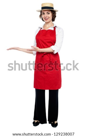 Full length portrait of a model in a bakers apron isolated against white. - stock photo