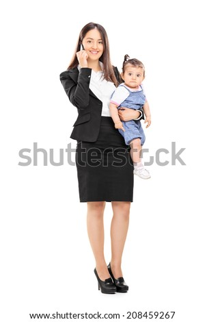 Full length portrait of a mother holding her daughter and talking on phone isolated on white background - stock photo