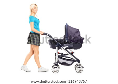 Full length portrait of a mother pushing a baby stroller isolated on white background - stock photo