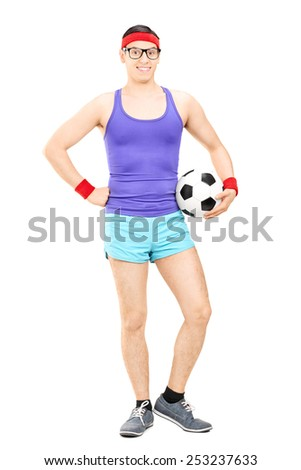 Full length portrait of a nerdy athlete holding a football isolated on white background - stock photo