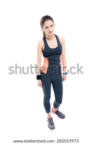 Full length portrait of a pensive sporty woman standing isolated on a white background - stock photo