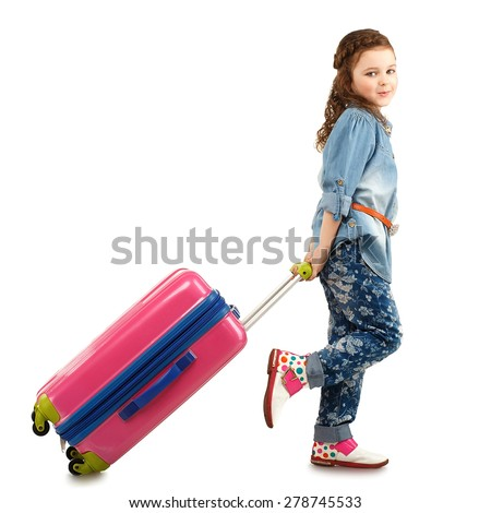 Full-length portrait of a pretty little girl with big pink suitcase on wheels isolated on white background. Concept holidays and vacations. - stock photo