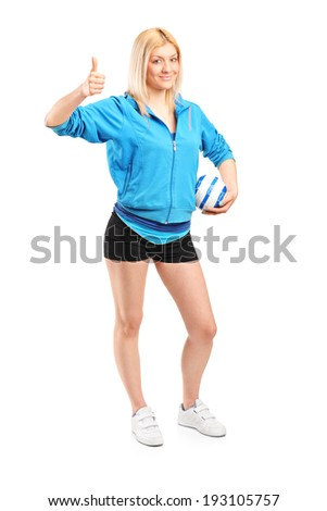 Full length portrait of a professional female handball player giving thumb up isolated on white background - stock photo