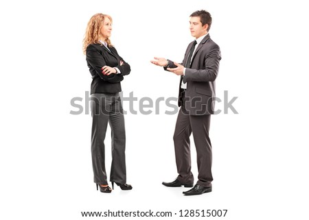 Full length portrait of a professional male and female having a conversation isolated on white background - stock photo