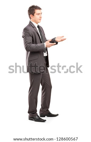 Full length portrait of a professional male shot during a conversation isolated on white backgroun - stock photo